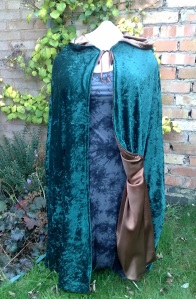 green cloak, brown satin lining, pixie hood with tassle